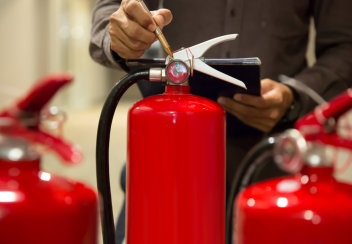 engineers are checking fire extinguishers