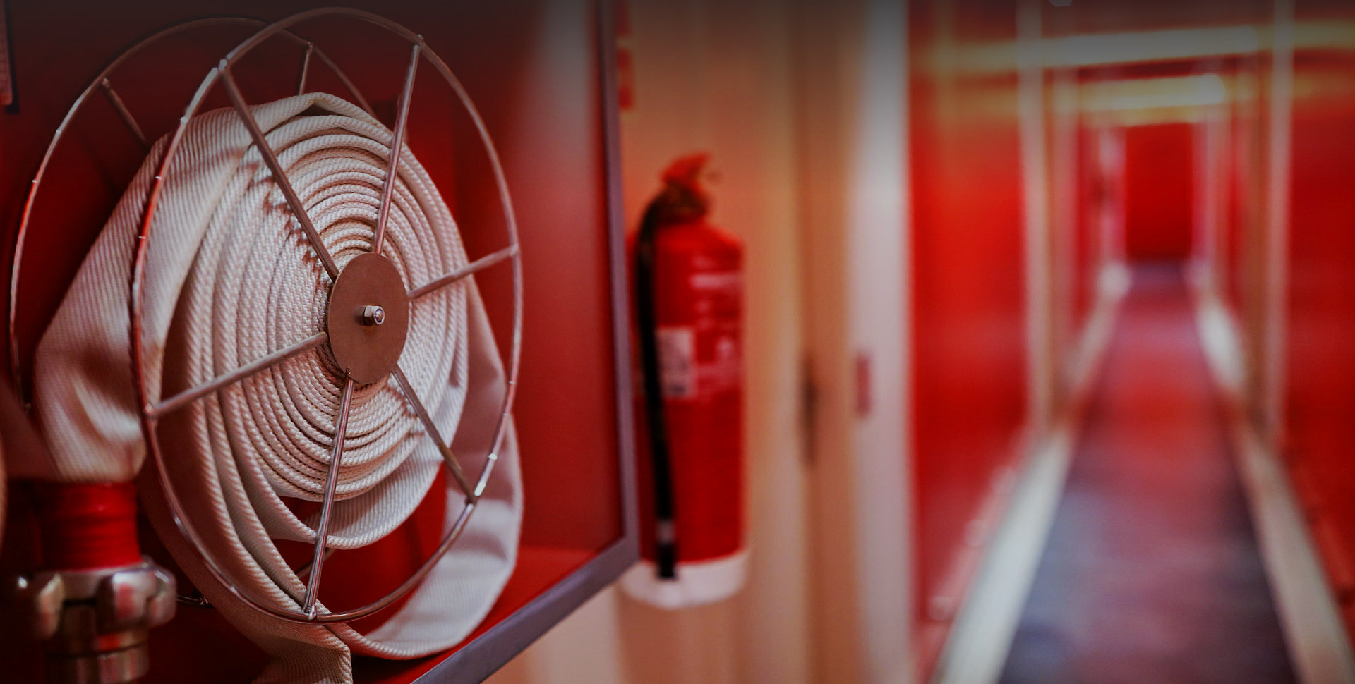 fire hose and a fire extinguisher