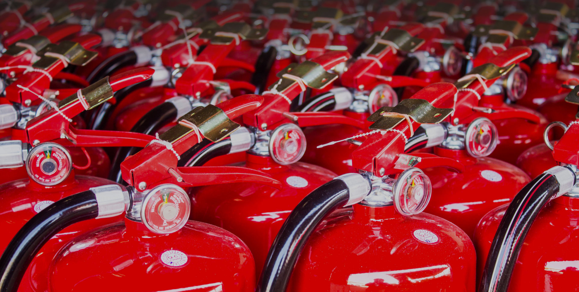red fire extinguishers. dust, alarm