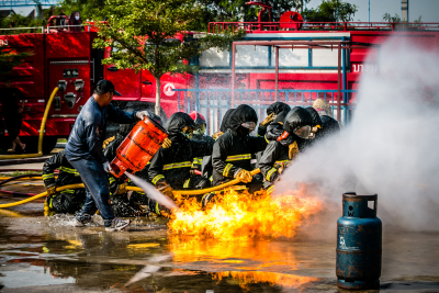 firefighters training in putting out fire