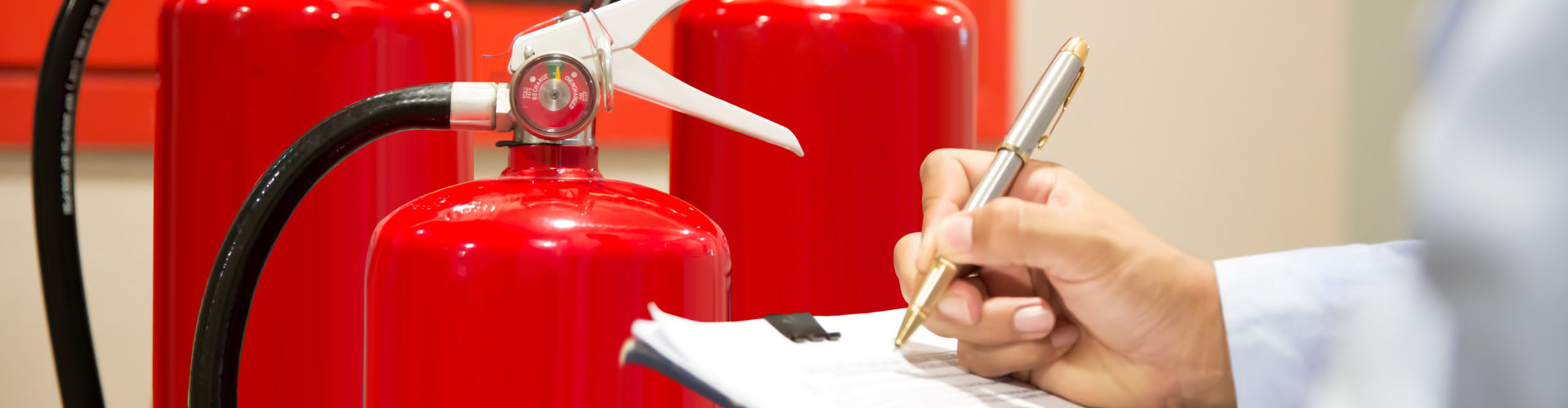 Engineer inspection Pressure gauge of Fire extinguisher.