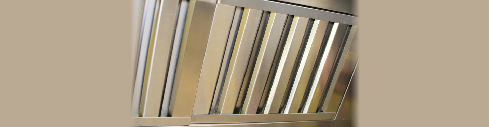 exhaust systems, hood filters detail in a professional kitchen. chrome, flue