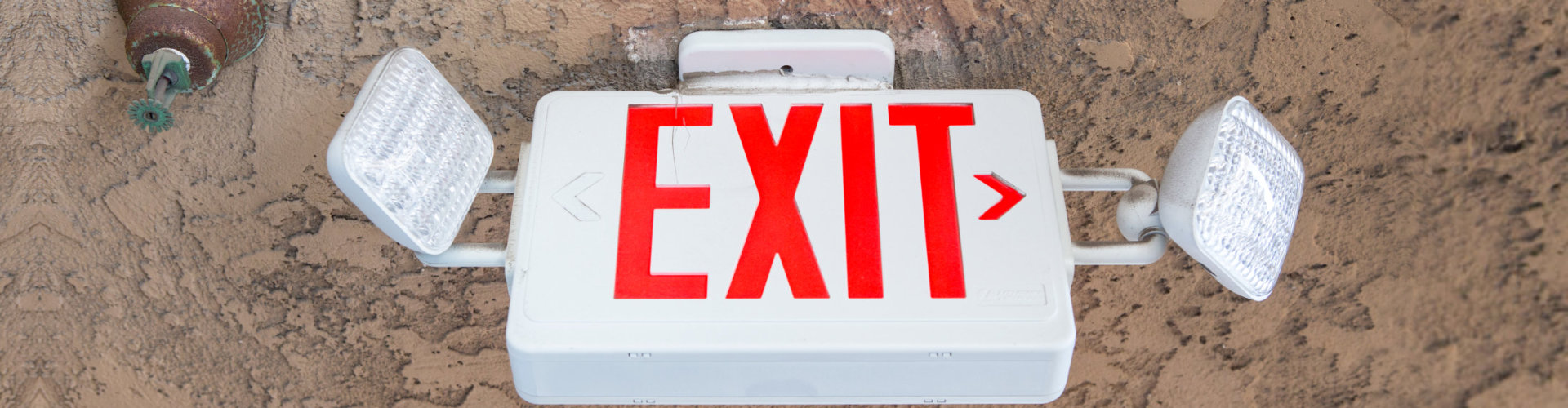 exit sign with emergency light and fire extinguishing system